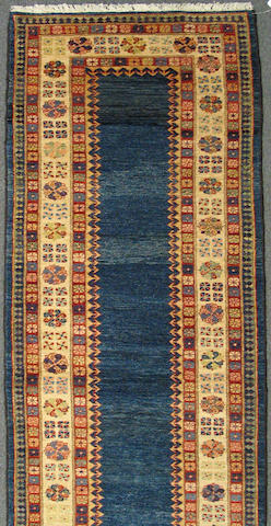 A Turkish runner size approximately 2ft. 9in. x 10ft. 6in.