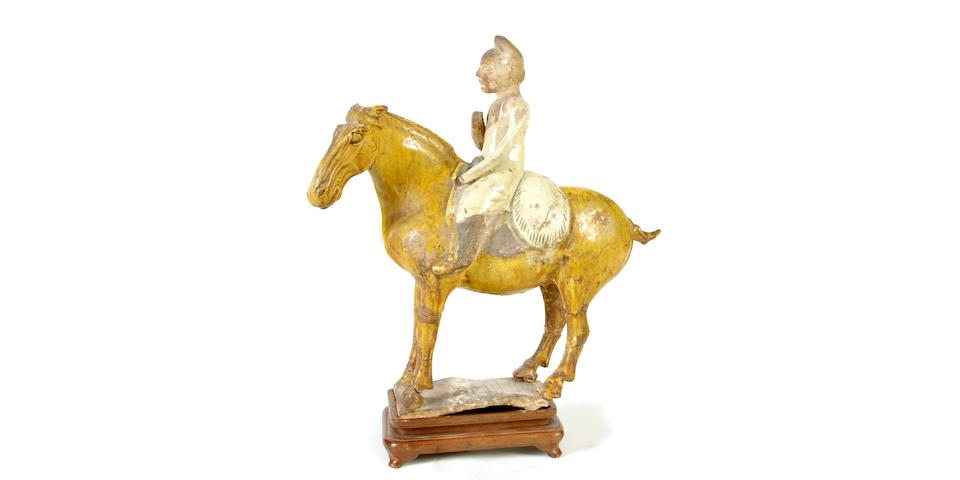 A Chinese chestnut glazed pottery equestrian   Tang Dynasty