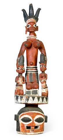 A Yoruba helmet crest Epa mask, Nigeria height 41in