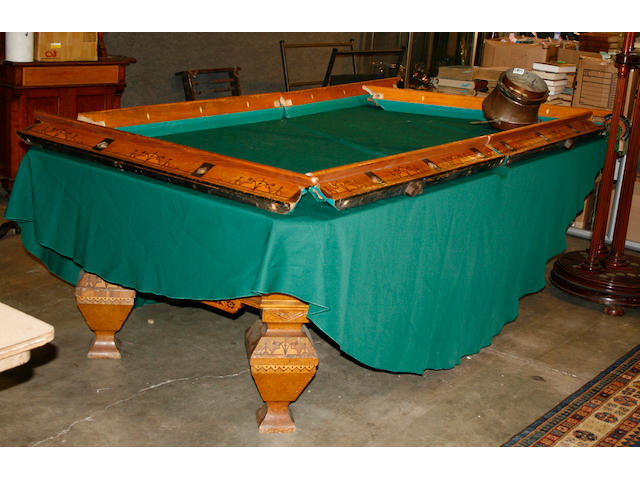 A Brunswick burled elm inlaid pool table together with a cue stand and a lamp shade