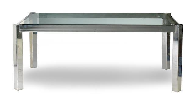 A contemporary chrome and glass dining table