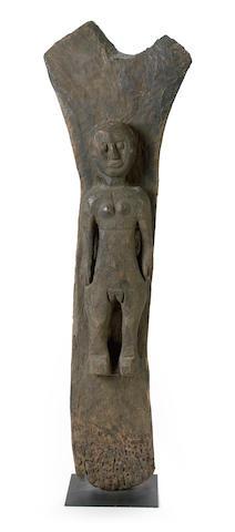 A Dogon Toguna figural post, Mali height 62 1/2in