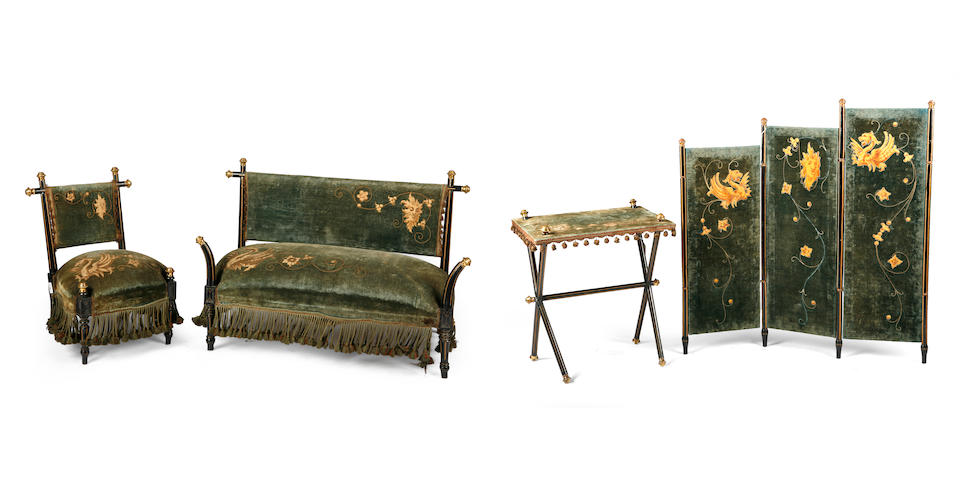 A French Aesthetic gilt metal mounted parcel gilt and ebonized suite of furniture