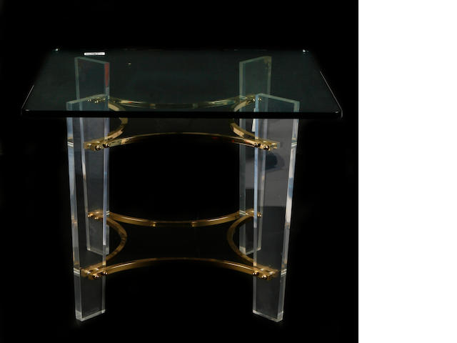 A contemporary acrylic and brass mounted side table