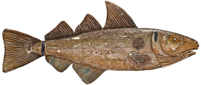 A large carved tradesman sign of a fish Early 20th century 76 x 32 in. (193 x 81.9 cm.)