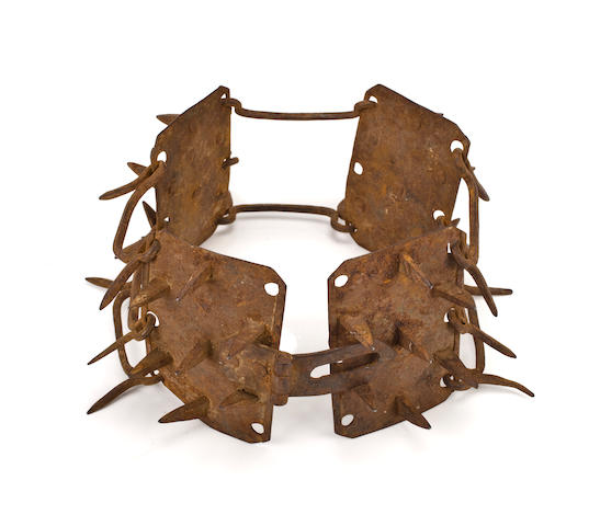 An iron collar with protective spikes, German, 17th century