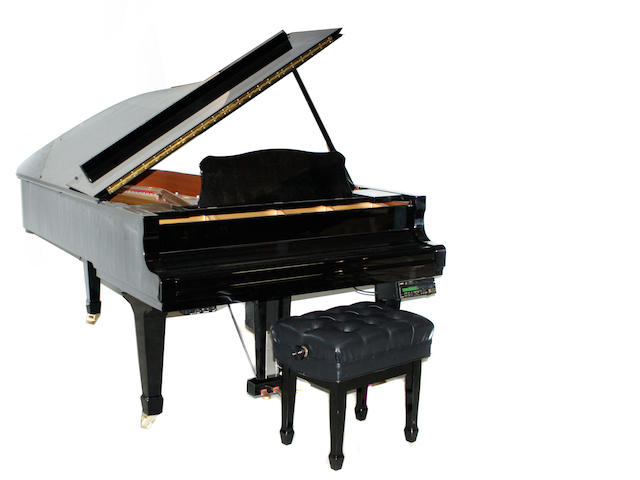 A Yamaha grand piano with Disklavier