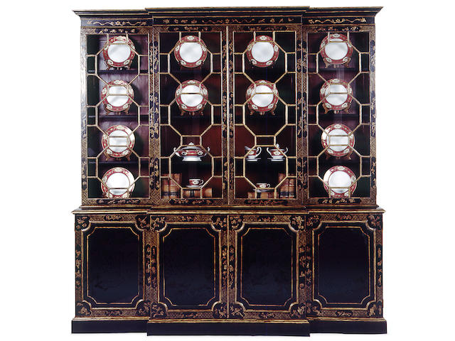 An imposing George III style lacquered and chinoiserie decorated breakfront bookcase cabinet
