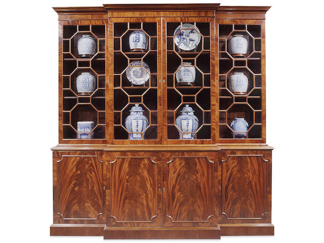 An imposing George III style mahogany breakfront bookcase cabinet