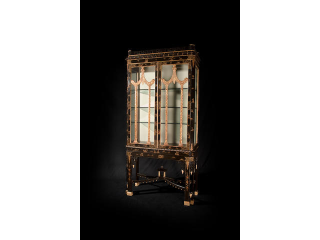 A Chinese Chippendale style black lacquered and chinoiserie display cabinet