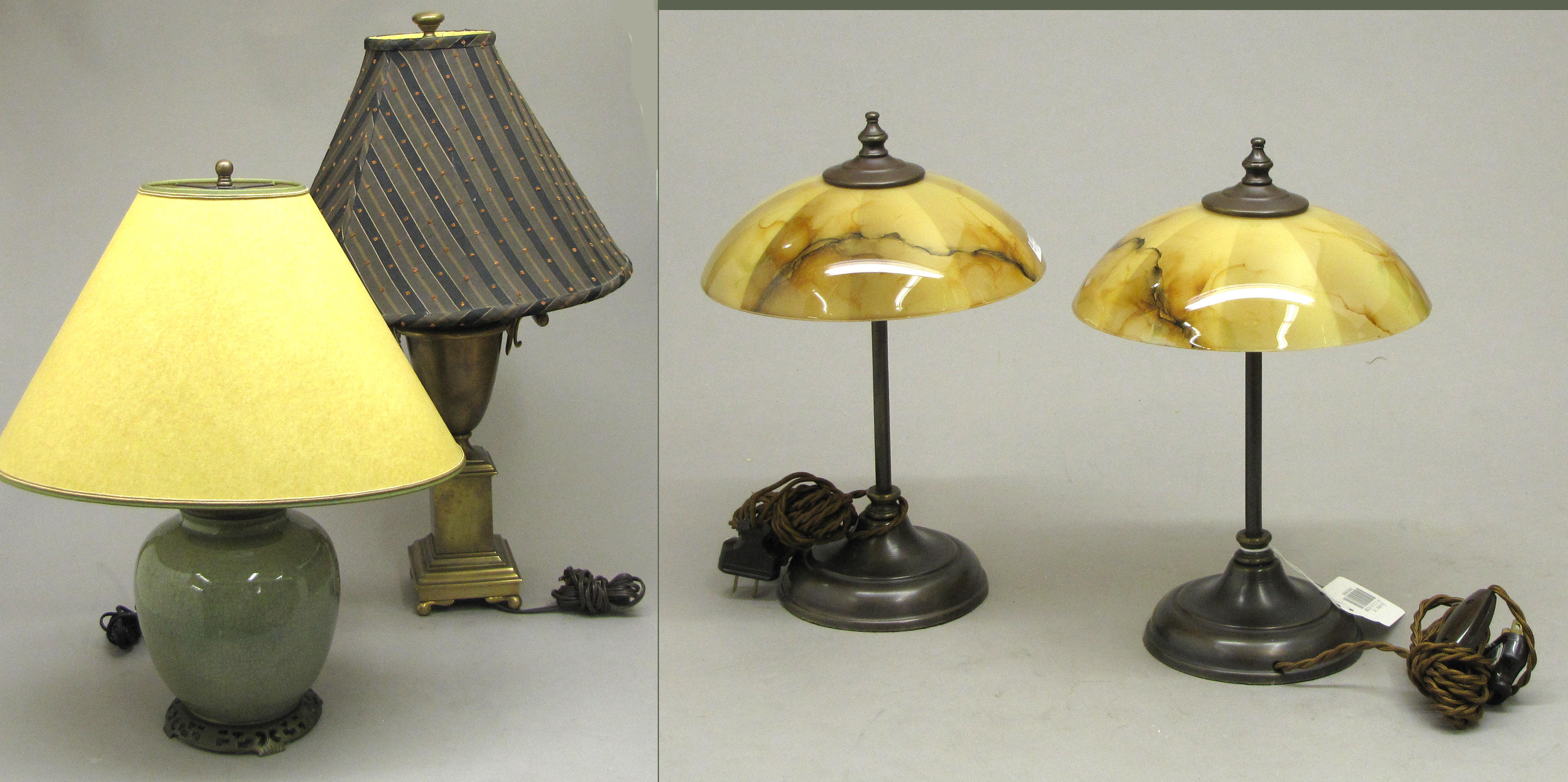 An assembled grouping of four table lamps