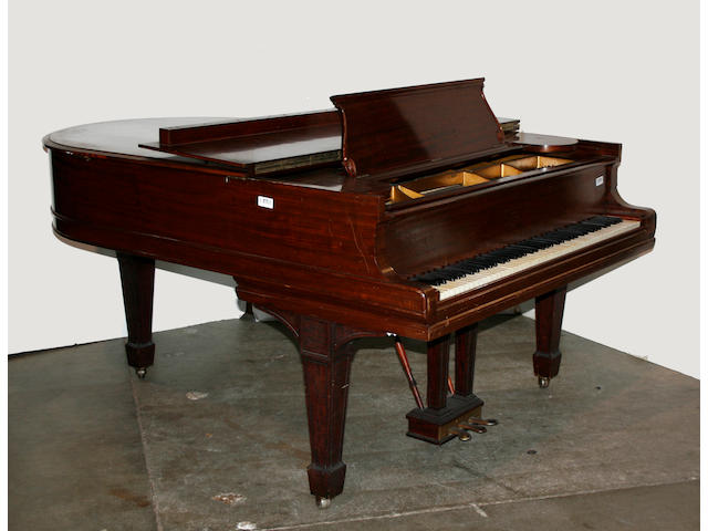 A Steinway and Sons  model O walnut grand piano