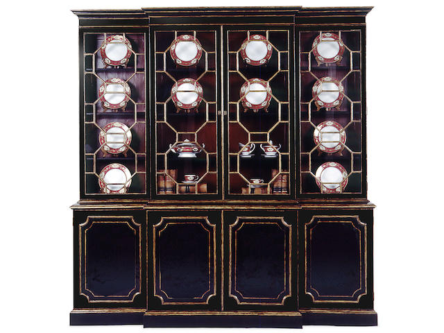 A George III style lacquered breakfront bookcase