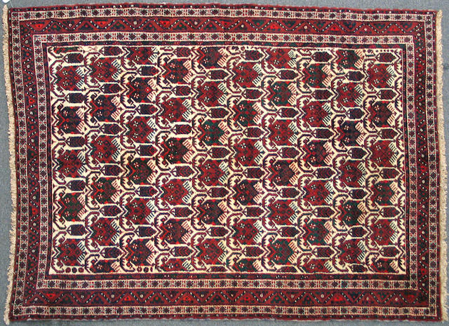 A Southwest Persian carpet size approximately 5ft. x 7ft.