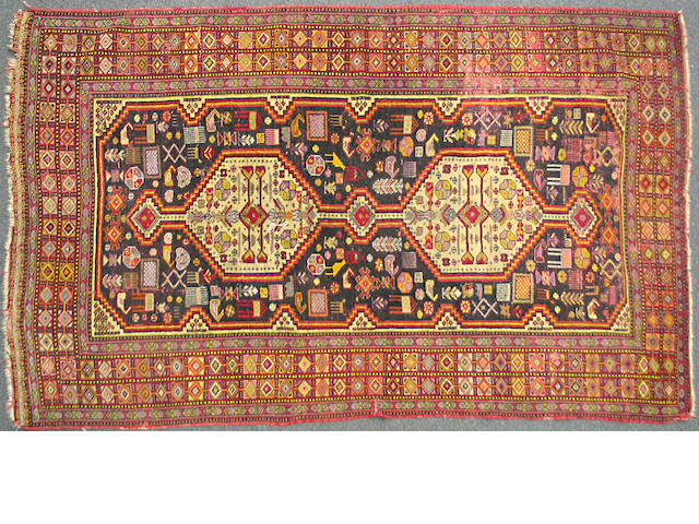 A Southwest Persian carpet size approximately 4ft. 8in. x 7ft. 5in.
