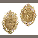 A pair of Continental Rococo style gilt bronze wall plaques