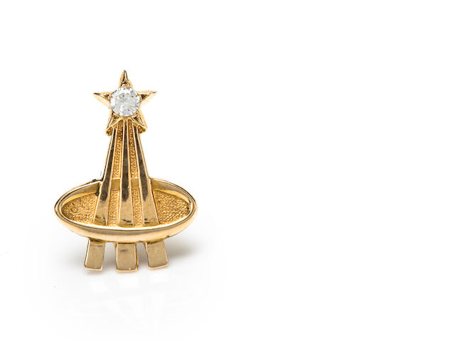 The Deke Slayton lapel pin, gold, inset diamond