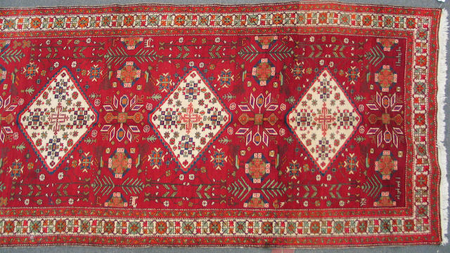 A Southwest Persian carpet size approximately 5ft. 2in. x 10ft.. 8in.