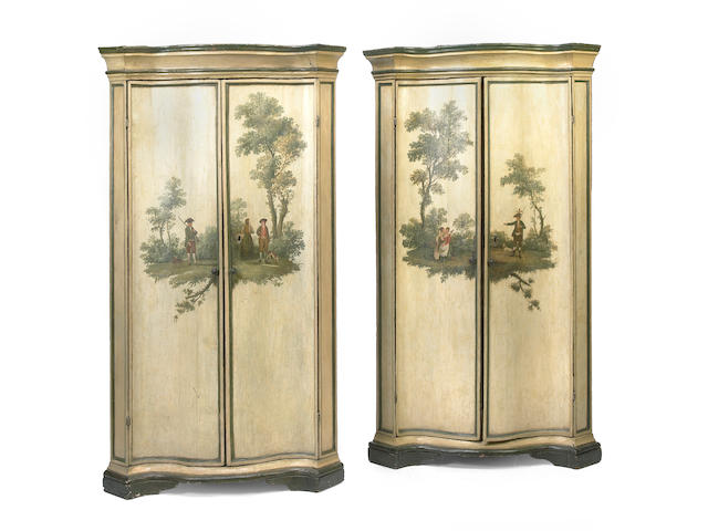 A pair of Italian Baroque later painted corner cupboards