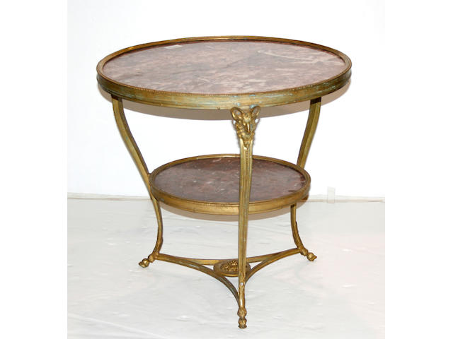 A pair of Neoclassical style marble top bronze tables