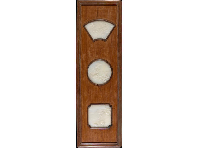 A pair of pieced wood wall panels mounted with white jade plaques