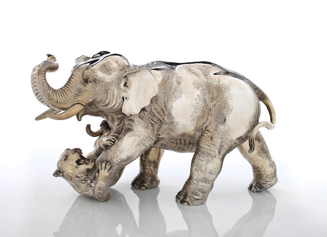 A SILVER MODEL OF AN ELEPHANT AND TIGER By Oshima Joun (1858-1940)