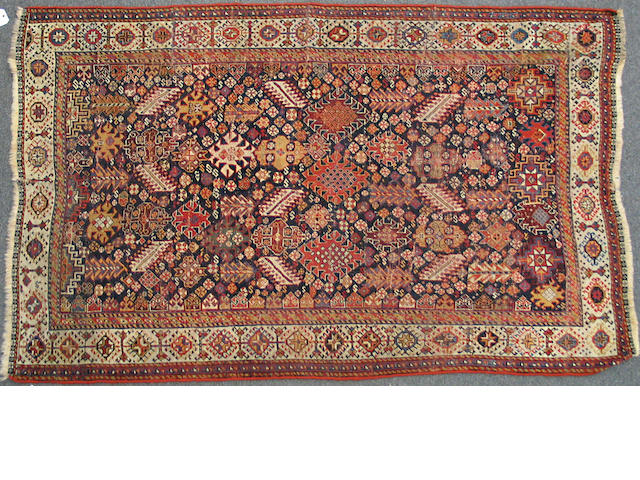 A Qashqa'i rug Southwest Persia, size approximately 4ft. 4in. x 6ft. 9in.