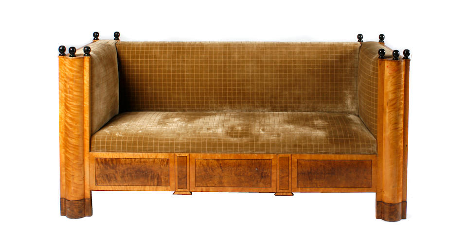 A Biedermeier maple and ebonized sofa