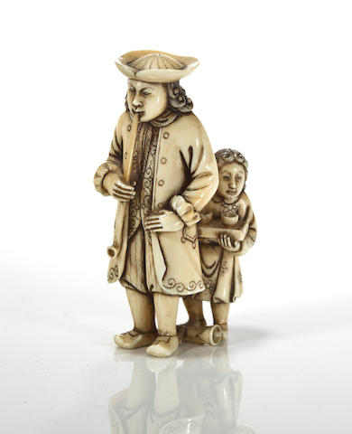An ivory standing dutchman smoking with child