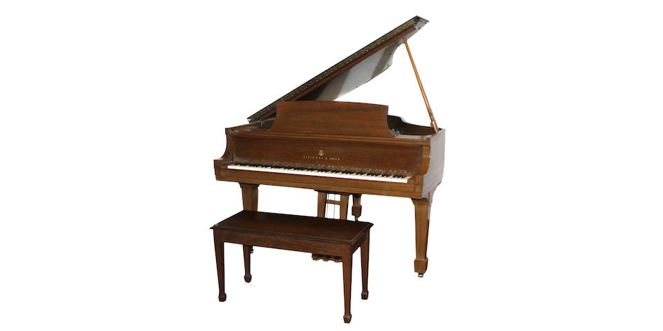 A Steinway & Sons walnut grand piano