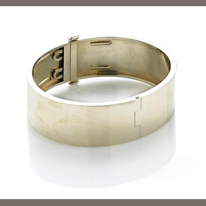 A fourteen karat white gold bangle, Trabert & Hoeffer Mauboussin
