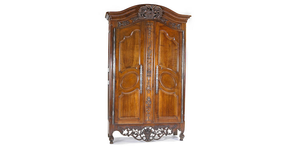 A fine Louis XVI walnut armoire  fourth quarter 18th century