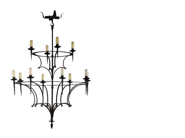 A Northern Italian Renaissance style wrought iron twelve light chandelier