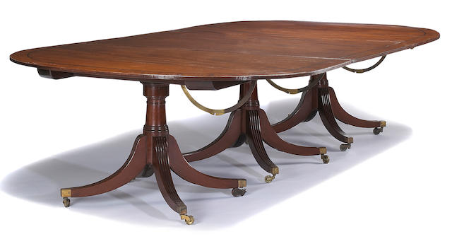 A Regency inlaid mahogany triple pedestal dining table early 19th century