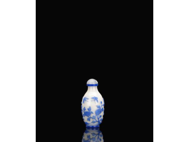 An unusual blue overlay glass snuff bottle 藍套白料蝶戀花鼻煙壺 Qianlong Period 乾隆