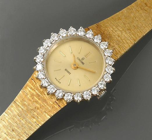 A diamond and fourteen karat gold ladies wristwatch, Concord