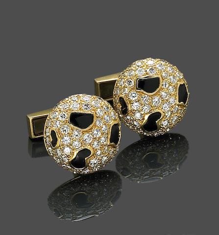A pair of diamond and black onyx cufflinks
