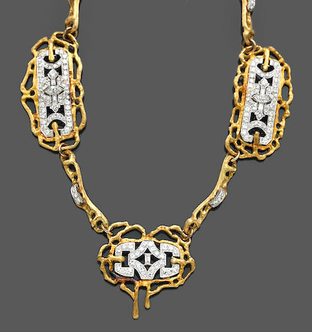 A diamond, platinum and eighteen karat gold necklace