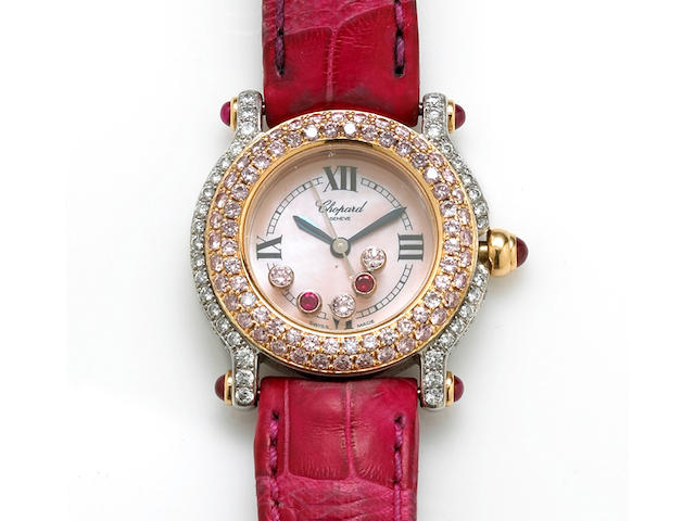 A lady's colored diamond, diamond, ruby and eighteen karat gold wristwatch, Chopard