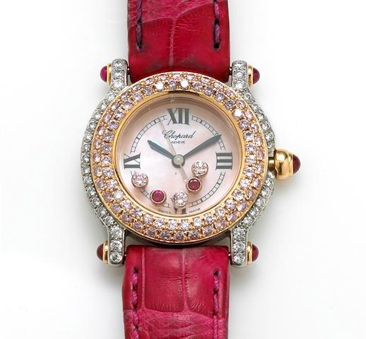 A lady's colored diamond, diamond, ruby and eighteen karat gold wristwatch, Chopard