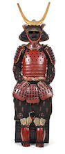 A RED-LACQUER SUIT OF ARMOR 18th century, the helmet by Myochin Hisaie