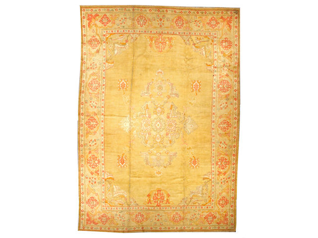 An Oushak carpet West Anatolia, size approximately 11ft. 11in. x 16ft. 8in.