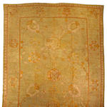 An Oushak carpet West Anatolia, size approximately 13ft. 5in. x 21ft.