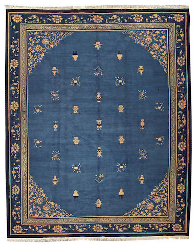 A Peking carpet China, size approximately 10ft. 10in. x 13ft. 5in.