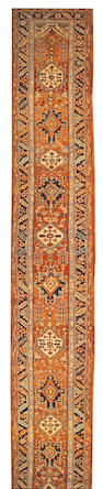 A Heriz runner Northwest Persia, size approximately 3ft. x 22ft. 7in.