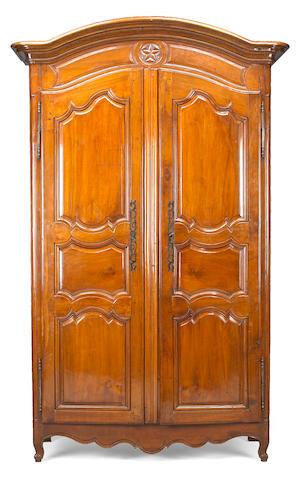 A Louis XV walnut armoire