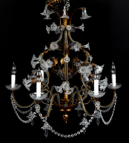 An Italian Neoclassical style carved giltwood, gilt tole and cut glass six light chandelier
