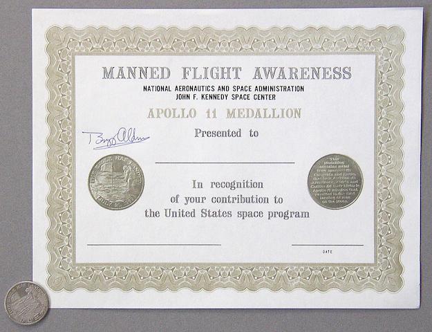 FLOWN APOLLO 11 MANNED FLIGHT AWARENESS MEDALLION.