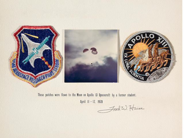 HAISE'S RESEARCH PILOT AND APOLLO 13 CREW EMBLEMS TAKEN ON APOLLO 13.