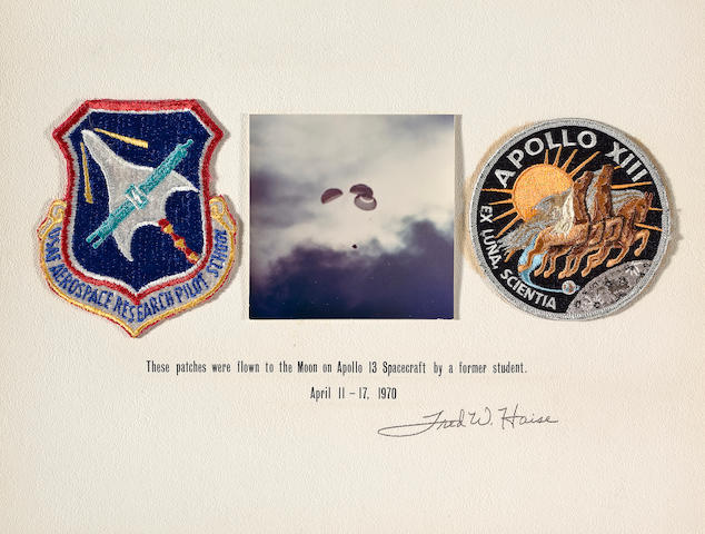 HAISE'S RESEARCH PILOT AND APOLLO 13 CREW EMBLEMS TAKEN ON APOLLO 13.